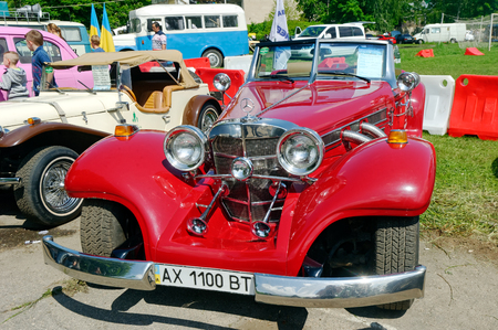 Kharkiv, Ukraine - May 22, 2016: Retro car red Mercedes-Benz Cabriolet manufactured in 1934 is presented at the festival of vintage cars Kharkiv Retro Rally - 2016 in Kharkiv, Ukraine on May 22, 2016