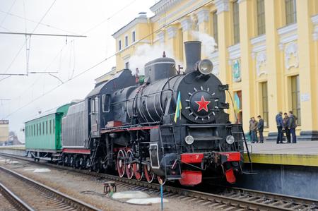 Kharkiv, Ukraine - November 4, 2016: Restored steam locomotive Er-794-12 and retro passenger car near the platform of railway station Kharkiv-Passazhyrsky in Kharkiv, Ukraine on November 4, 2016 Editorial