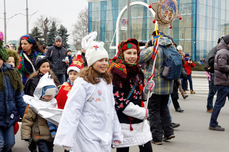 Kharkiv, Ukraine - January 13, 2018 - Participants traditional Christmas of Verteps Parade (nativity Scene), Christmas stars, carols singing. People wearing carnival clothes posing and smiling. Winter outdoor image. Editorial