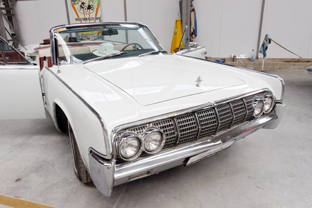 Kharkiv, Ukraine - May 19, 2018: Retro car white Lincoln Continental cabrio manufactured in 1963 is presented at the festival of vintage cars Kharkiv Retro Rally - 2018 in Kharkiv, Ukraine on May 19, 2018