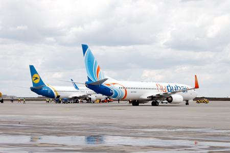 Kharkiv, Ukraine - June 8, 2012: A passenger plane Boeing 737-400 of Ukraine International Airlines and Boeing 737-800 of FlyDubai at Kharkiv International Airport
