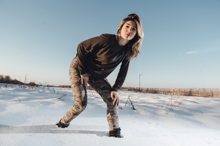christmas military: Military style portrait of cute lady on winter background Stock Photo