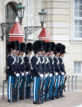 COPENHAGEN, DENMARK - MAY 17, 2012: Shanging of the honor guard at the Royal Palace Amalienborg in Copenhagen Editorial