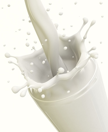 glass of milk: Pouring milk in a glass created splash, isolated on white. Stock Photo