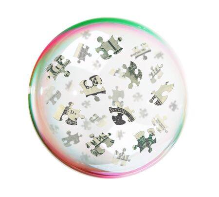 Puzzles of the dollar into big soap bubble, white background photo