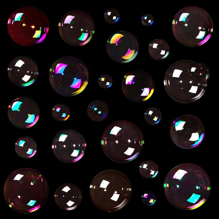 Colorful natural soap bubbles isolated on black background Stock Photo