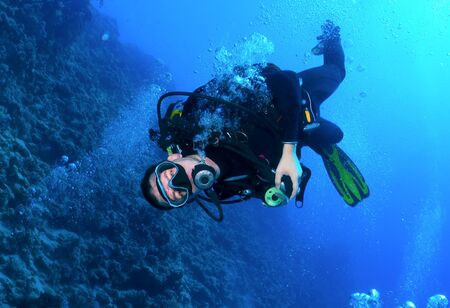 Diver in the background of the reef Stock Photo - 12767311