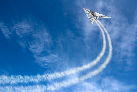 Hundred dollars plane on cloudy sky and trace