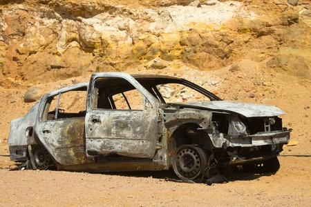 Crashed car wreck in desert landscape  Stock Photo