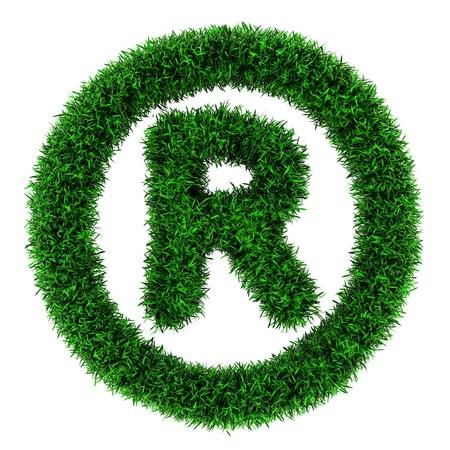 Symbol für eingetragene Marke, aus Gras isoliert auf weißem Hintergrund Standard-Bild