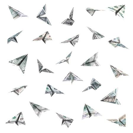 白い背景で隔離のドル紙幣から紙飛行機