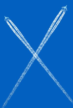 Two crossing airplane traces against blue sky   photo