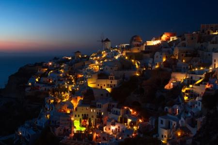 aegean sea: Oia village at night on Santorini island, Greece.