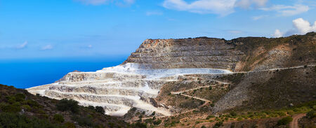 quarries: Panoramic view of Marble quarry near village Mochlos, Crete, Greece. Stock Photo