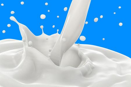Splash de leche con verter sobre fondo azul. Foto de archivo