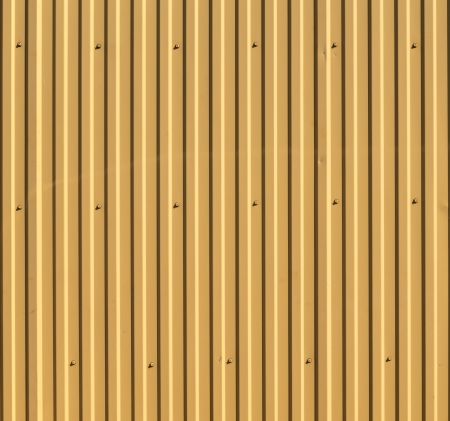 Corrugated steel fence fragment  May be used as background or texture                                Stock Photo