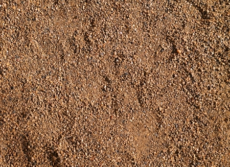 Fine gravel or coarse sand texture or background                                Stock Photo