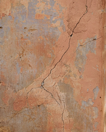 Painted cracked concrete wall fragment  May be used as background or texture