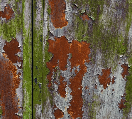 Old metal  surface covered with several peeling layers of paint Stock Photo - 15768744
