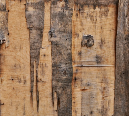Aged plywood door fragment  May be used as texture or background Stock Photo