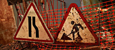 road works: Grungy road signs  road narrows and road works on damaged road