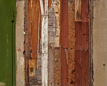 Aged damaged door made of various wooden materials. Useful as grunge background. Stock Photo - 15821272