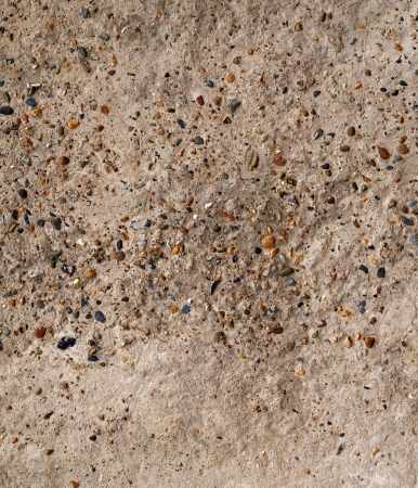 Old concrete wall with pebble inclusion. May be used as background or texture. Stock Photo - 15821284