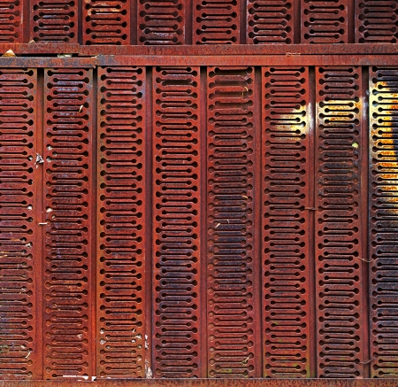 oxidate: Grunge rusted metal wall made of grating. May be used as background or texture Stock Photo
