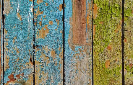 Old wooden wall with cracked paint traces photo