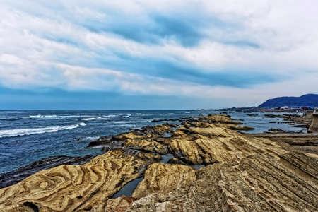 Japan Chiba coast. Rocks, sky and waves