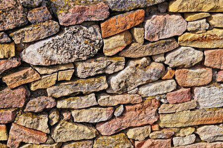 Ancient stonework made of rough uneven blocks Stock Photo