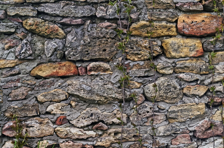 uneven: Ancient stonework made of rough uneven blocks Stock Photo