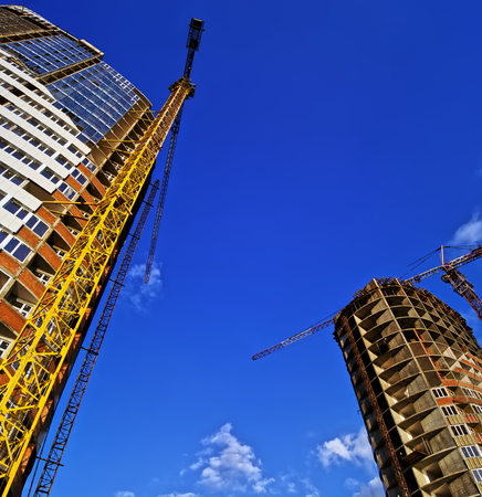 developing: Developing high-rise concrete residential building with crane