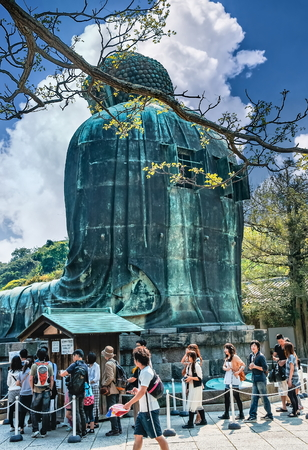 KAMAKURA, JAPAN - MAY 05, 2012 : Daibutsu - Tourists near famous Great Buddha  statue on the grounds of Kotokuin Temple in Kamakura, Japan Editorial