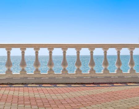 White baluster overlooking sea horizon