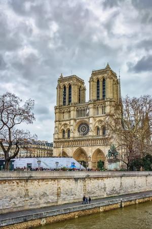 champs elysees: PARIS, FRANCE - DECEMBER 26, 2012 : Cathedrale Notre Dame (Notre-Dame de Paris) seen from Petit Pont, Paris, France Editorial