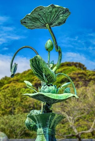 Bronze Lotus Plant in front of the Daibutsu (Great Buddha) of Kamakura, Japan