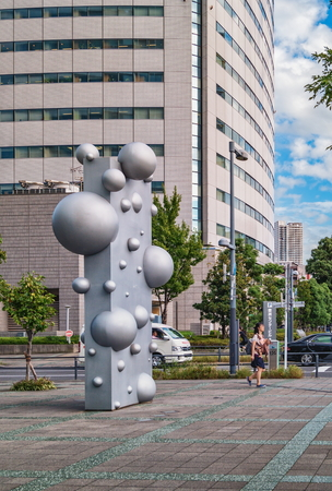 TOKYO, JAPAN - OCTOBER 02, 2015 : Abstract street sculpture with balls in Tokyo, Japan Editorial