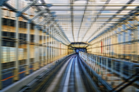 Tokyo monorail transportation system Yurikamome Line in tunnel over Rainbow bridge. Blurred with speed