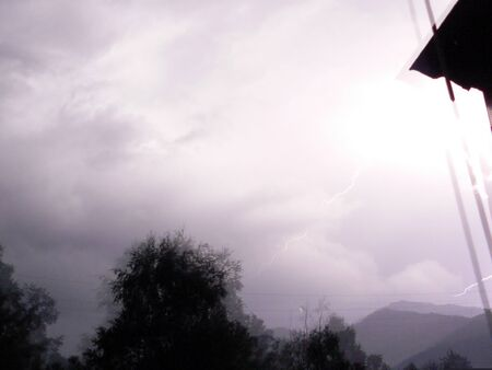 Flash and impact of a lightning at night photo