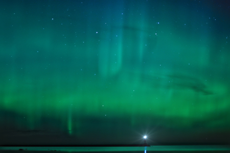magnetosphere: Night landscape with Aurora Borealis over the Ladoga Lake and a lighthouse