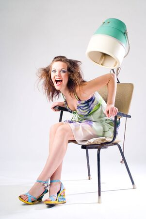 Girl and Hair Dryer Stock Photo
