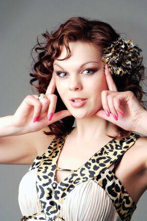 A young pretty flirting girl studio portrait photo