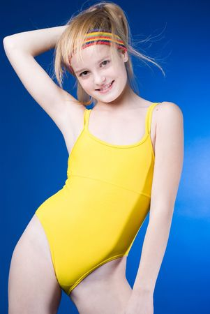 gymnastics sports: Young sportive girl portrait on blue background