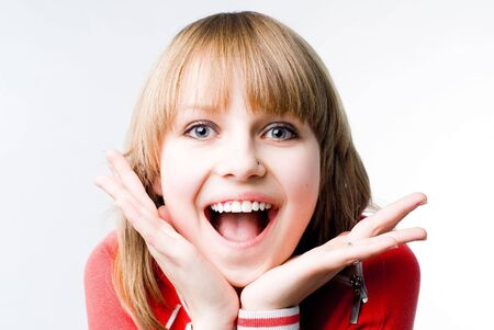Delightful screaming pretty girl portrait on white background
