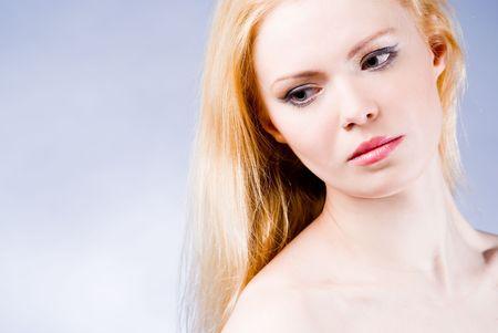 A young beautiful pensive girl studio shot photo