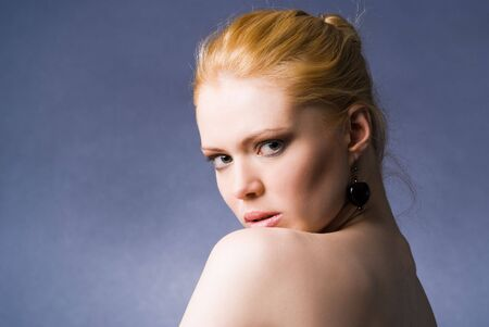 A young beautiful seducing girl studio shot photo