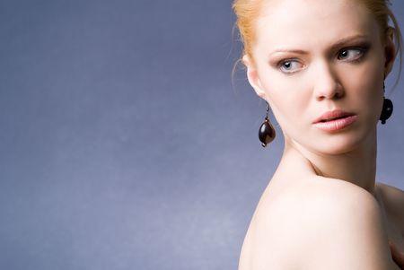 A young beautiful seducing girl studio shot  Stock Photo