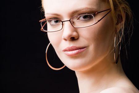 A young beautiful woman in glasses studio shot photo