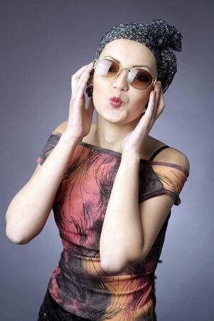 A young beautiful woman studio closeup portrait photo